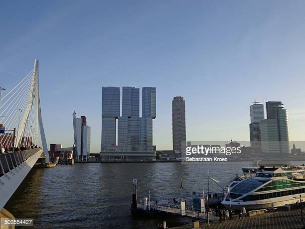 CONTENT] A view over the skyline of Rotterdam including the Erasmus Bridge by architect Calatrava and the building called de Rotterdam by Architect...