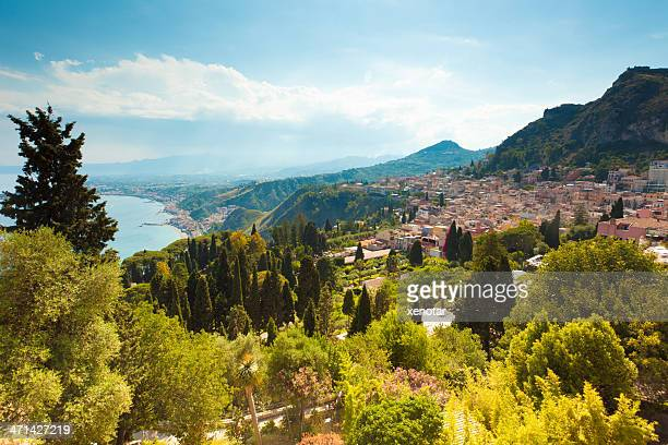 view over town with mount etna in background - mt etna stock pictures, royalty-free photos & images