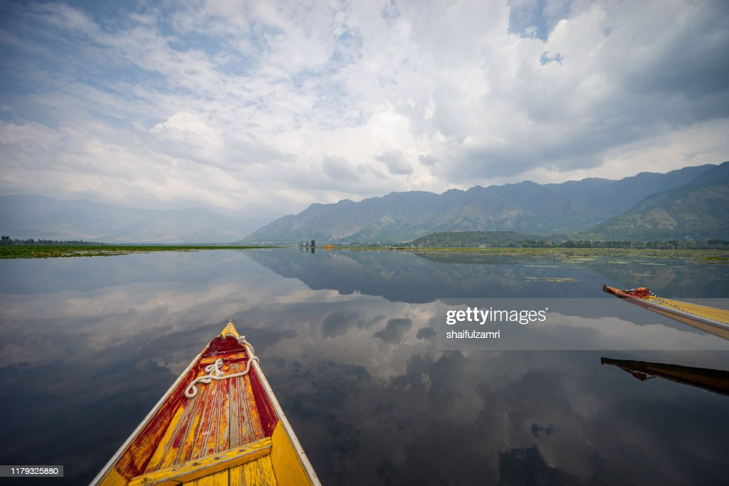 View over traditional boat or shikara - a type of wooden boat at Dal Lake. : Stock Photo