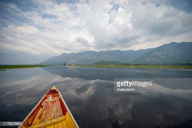 view over traditional boat or shikara - a type of wooden boat at dal lake. - shaifulzamri stock pictures, royalty-free photos & images