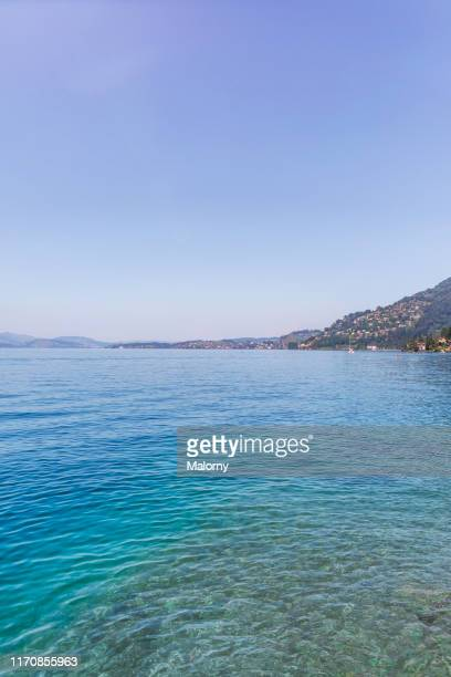 view over turquoise colored lake lucerne, mountain range in the background. - schwyz stock pictures, royalty-free photos & images