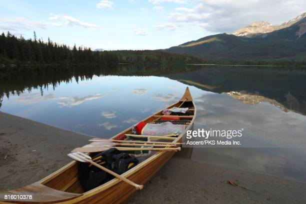 View past canoe to beautiful mountain lake