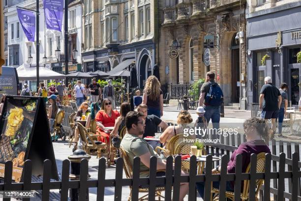 View people drinking and dining out in St Mary Street in sunny weather on June 01, 2021 in Cardiff, Wales. 2 274 people in Wales have now had their...