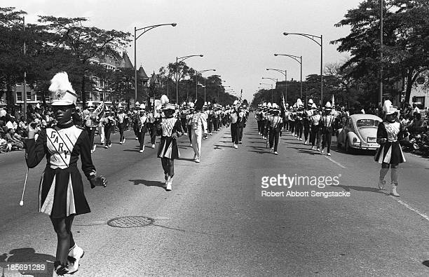 View showing a high school marching band from Gary Indiana as it participates in the Bud Billiken Day parade Chicago Illinois mid to late 1960s