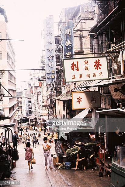View Showing A Narrow Street With Shops In Hong Kong During The Seventies