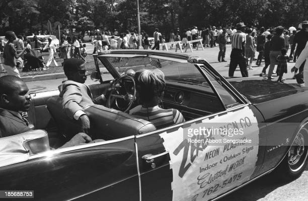 View showing the car sponsored by the Zeker Sign Company, a local business, during the Bud Billiken Day parade, Chicago, Illinois, mid to late 1960s .