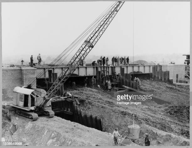 View showing the deck of Structure 112 in position, a railway bridge over the London to Yorkshire Motorway , as a Ruston Bucyrus machine hoists...