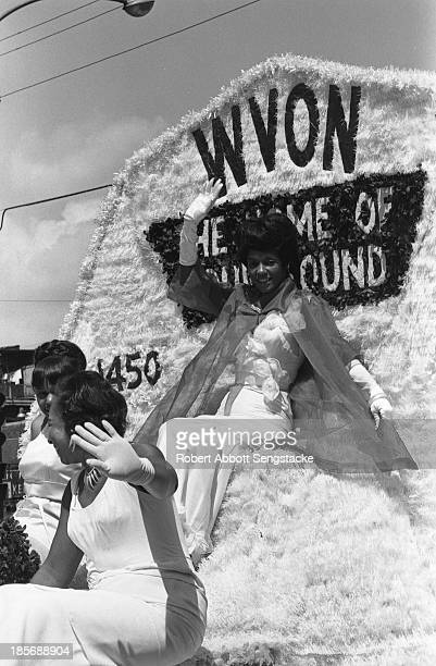 View showing women riding on the float sponsored by the WVON radio station during the Bud Billiken Day parade Chicago Illinois mid to late 1960s The...