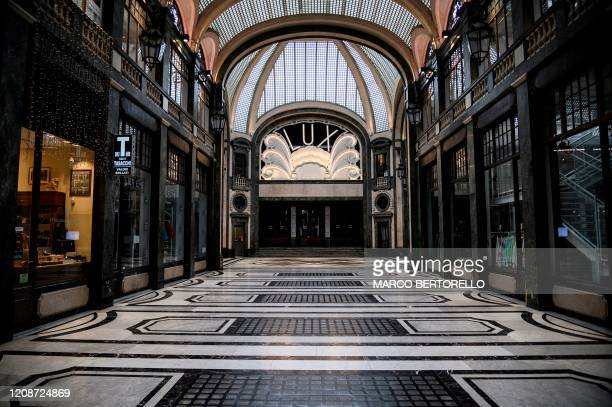 A view shows a deserted Galleria San Federico shopping mall on March 31 2020 in Turin during the country's lockdown aimed at curbing the spread of...