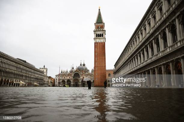 """View shows a flooded St. Mark's Square on December 8, 2020 following a high tide """"Alta Acqua"""" event following heavy rains and strong winds, and the..."""