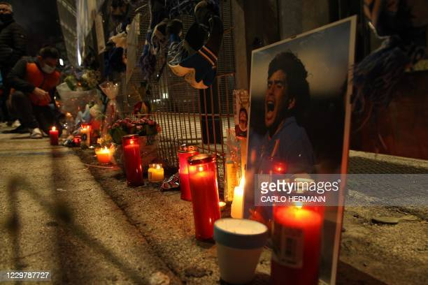 View shows a makeshift shrine set up at the main entrance of the San Paolo stadium in Naples on November 25, 2020 with an image of Argentinian...