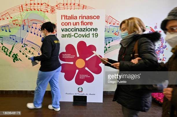 View shows a sticker with a primrose, the symbol chosen for the vaccination campaign, as elderly people wait to receive a dose of the Pfizer-BioNTech...