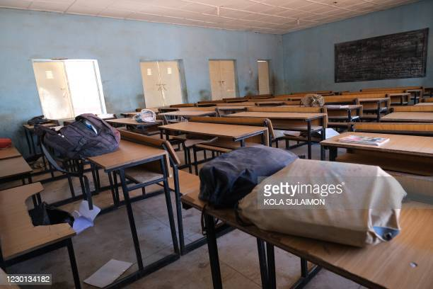 View shows an empty classroom with school bags and wares belonging to pupils at the Government Science school where gunmen abducted students, in...