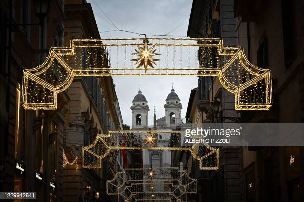 View shows Christmas decorations on Via dei Condotti and the Trinita dei Monti church in downtown Rome on December 4 during the government's...