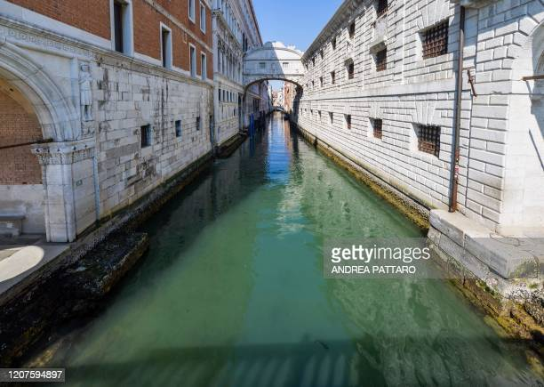 View shows clear waters below the Bridge of Sighs in a Venice canal on March 18, 2020 as a result of the stoppage of motorboat traffic, following the...