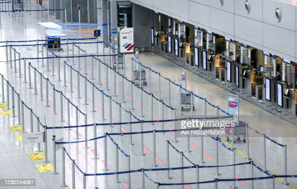 View shows empty check-in counters at Duesseldorf Airport in Duesseldorf, western Germany, on December 21 amid the ongoing novel coronavirus /...