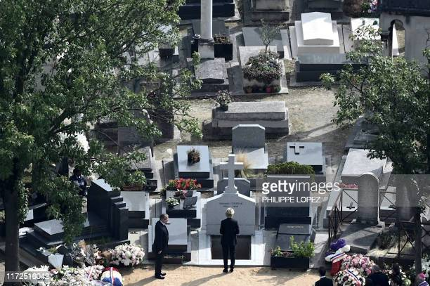 TOPSHOT A view shows former French President Jacques Chirac's daughter Claude Chirac paying her respects by the tomb of her father during a private...