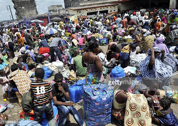 View shows people waiting to board buses at the Adjame bus station in Abidjan on March 22 2011 Thousands of residents of Abidjan stream into bus...