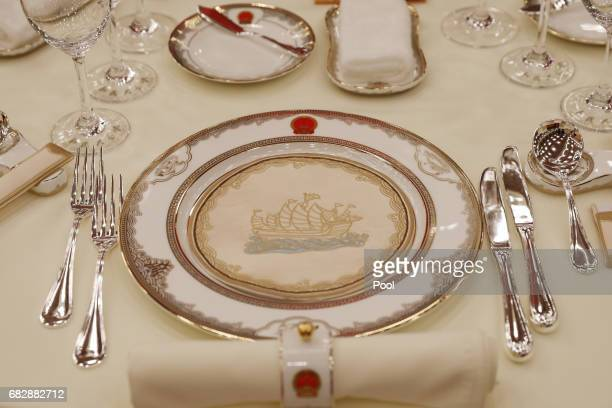A view shows tablewares placed on the table ahead a welcome banquet for the Belt and Road Forum at the Great Hall of the People in Beijing China 14...