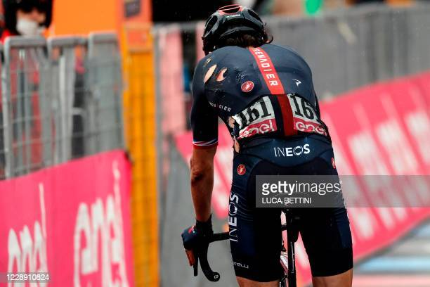 View shows Team Ineos rider Great Britain's Geraint Thomas' ripped jersey following an early fall in the stage, as he turns around immediately after...