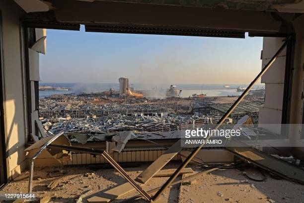 TOPSHOT A view shows the aftermath of yesterday's blast at the port of Lebanon's capital Beirut on August 5 2020 Rescuers worked through the night...