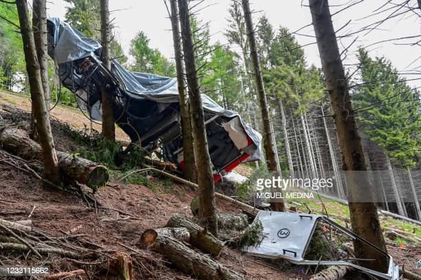 View shows the cabin's wreckage covered with a tarpaulin on May 26, 2021 on the slopes of the Mottarone peak above Stresa, Piedmont, three days after...