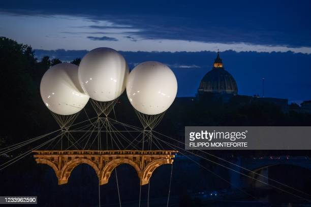 """View shows """"The Farnese Bridge"""", a participatory monumental cardboard installation by French artist Olivier Grossetete, over the Tiber river in front..."""