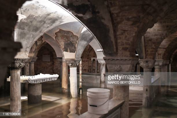 """View shows the flooded crypt of St. Mark's Basilica after an exceptional overnight """"Alta Acqua"""" high tide water level, on November 13, 2019 in..."""