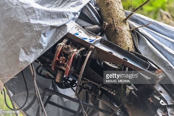 """View shows """"the fork"""" , a piece that allegedly prevented the brakes from working, on the cabin's wreckage covered with a tarpaulin on May 26, 2021 on..."""
