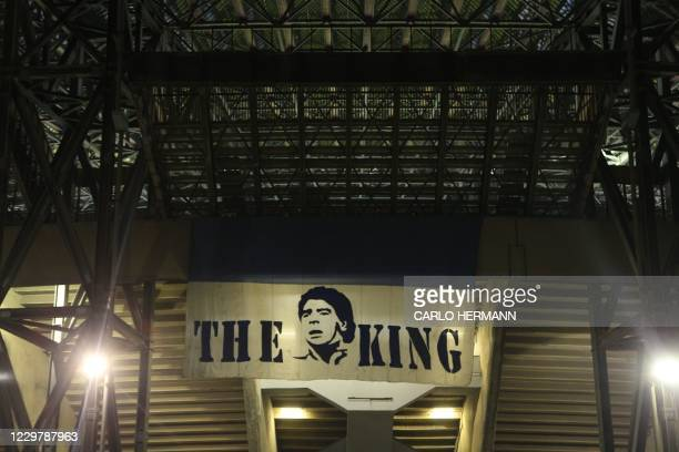 View shows the main entrance of the San Paolo stadium in Naples on November 25 with an image of Argentinian football legend Diego Maradona reading...