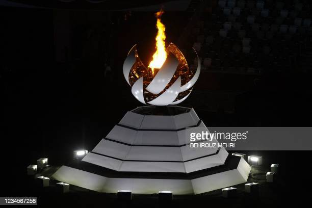 View shows the Olympic Cauldron and the Olympic flame during the closing ceremony of the Tokyo 2020 Olympic Games, on August 8, 2021 at the Olympic...