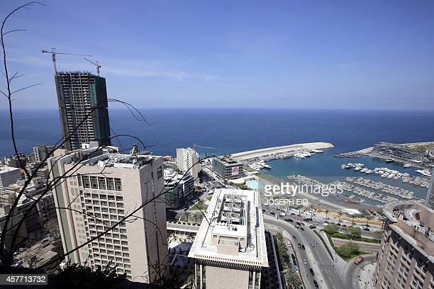 A view shows the Phoenicia hotel Saint Georges Yaght club and Beirut waterfront city from the 25th floor of the Holiday Inn hotel in Beirut on April...