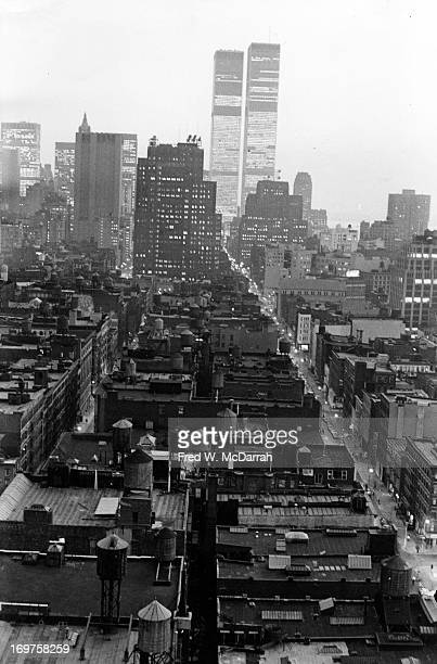 View south across the rooftops of Soho New York New York March 5 1977 The street at left is Sullivan and at right 6th Avenue The World Trade Center...