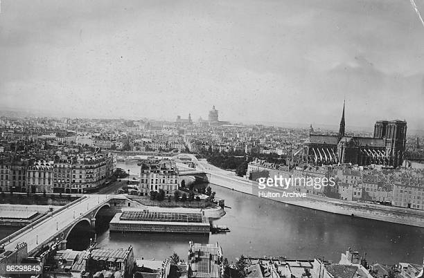 A view southwards across the River Seine in Paris circa 1880 The Ile SaintLouis is on the left and the Ile de la Cite on the right with the cathedral...