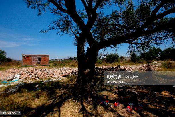 View taken at the farm where remains of at least 25 people were found buried in a clandestine mass grave in the municipality of El Salto, outside the...