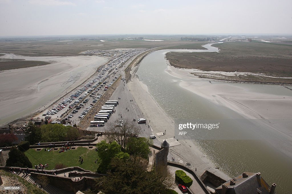 View taken on April 21, 2010, in Le Mont-Saint-Michel, northwestern France, of the causeway between Mont-Saint-Michel and the mainland which has been built up over the years to form a car park for the ever increasing tourist numbers is being dismantled to return Mont Saint-Michel to its original state. Mont Saint-Michel and its bay are part of the UNESCO list of World Heritage Sites for its cultural, historical, and architectural significance.