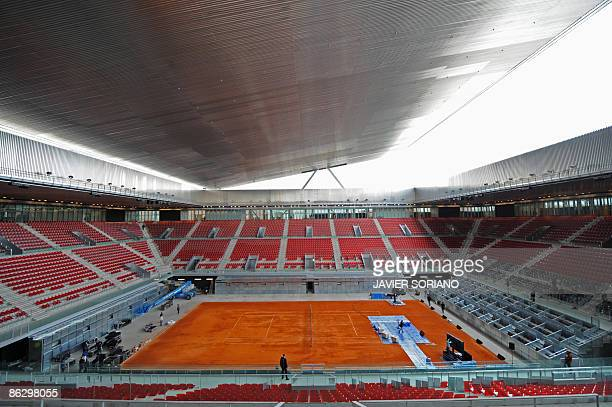 View taken on April 30, 2009 in Madrid of the Magic Box arena by French architect Dominique Perrault, newly built to host the Madrid Combined Tennis...