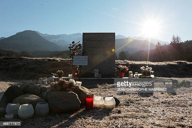 A view taken on April 6 2015 in the early morning shows a memorial for the victims of the March 24 Germanwings Airbus A320 crash in the village of Le...