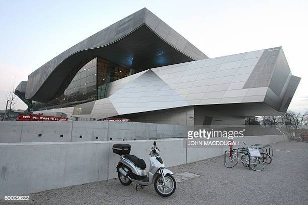 View taken on February 20 2008 shows a motorcycle parked in front of German car manufacturer BMW's 'BMW World' complex in Munich built by the...