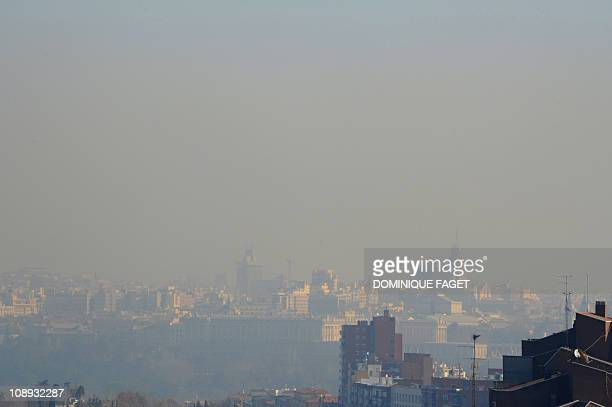 A view taken on February 9 2011 from Casa de Campo park in the west of Madrid shows the pollution covering the sky of the Spanish capital The cities...