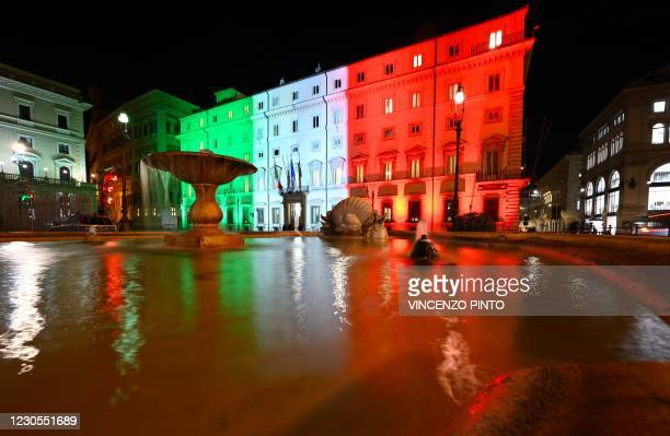 View taken on January 12, 2021 in Rome shows the Palazzo Chigi, the seat of the Italian government, lit with the colors of the Italian flag as...