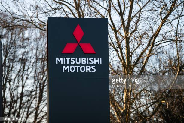 View taken on January 21, 2020 shows the logo of Japanese automaker Mitsubishi at their plant in Friedberg, western Germany. - German prosecutors on...