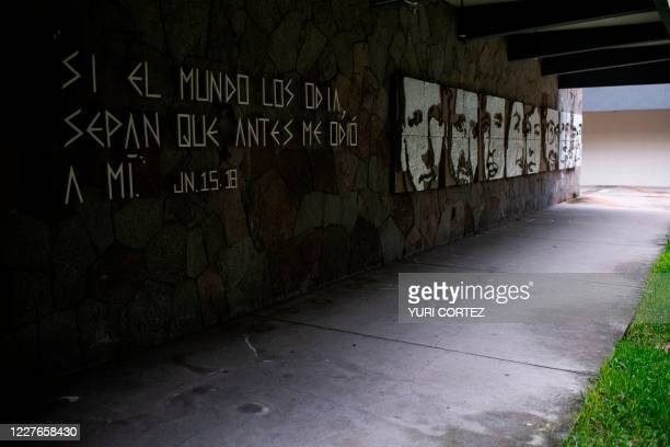 View taken on July 15, 2020 of a mural made by visual artist Josue Villalta placed on the wall of a building of the Jose Simeon Canas Central...