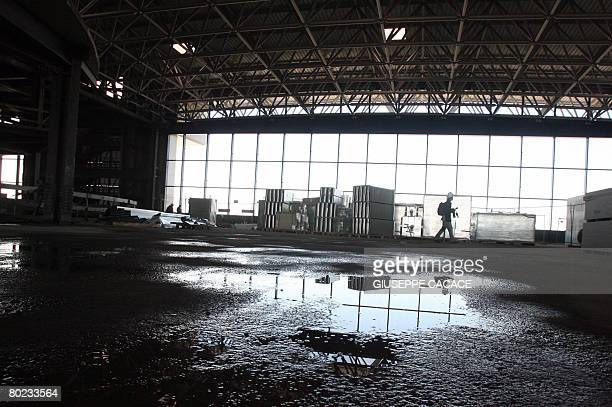 A view taken on March 13 2008 shows the new building under construction in the Terminal 1 of Malpensa Airport north of Milan The province of Milan...