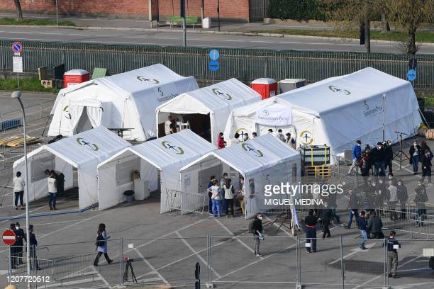 A view taken on March 20 2020 in Cremona southeast of Milan shows tent from a newly operative field hospital for coronavirus patients financed by US...
