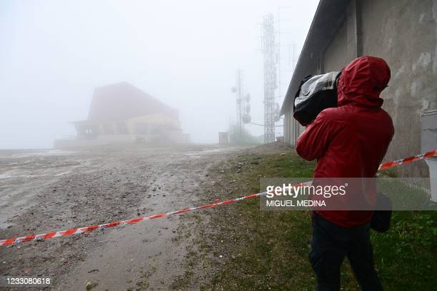 View taken on May 24, 2021 shows a journalist working by the cordoned off access to the arrival building of the Stresa to Mottarone cableway at the...