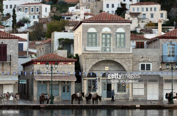 View taken on November 12, 2016 shows the port of the Greek island of Hydra. - Among the legions of fans mourning the death of Leonard Cohen at age...