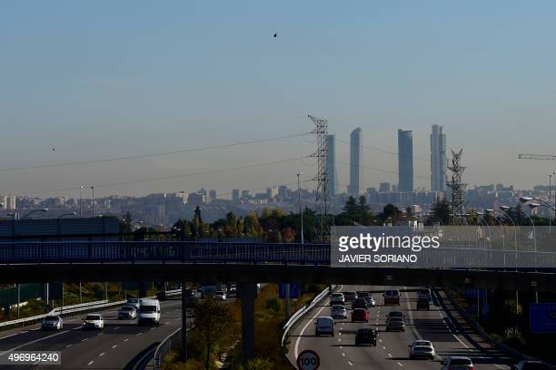 A view taken on November 13 2015 shows cars on a speedway as the pollution covers the sky of Madrid Madrid City Council took on November 13 2015...