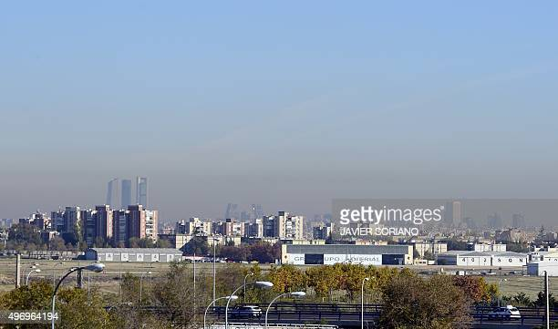 A view taken on November 13 2015 shows the pollution covering the sky of the Spanish capital Madrid City Council took on November 13 2015 measures...