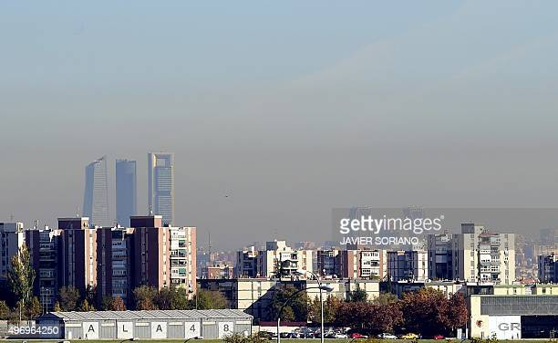 A view taken on November 13 2015 shows the pollution covering the sky of Madrid Madrid City Council took on November 13 2015 measures limiting...